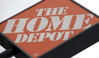 In this Tuesday, Aug. 14, 2012, file photo, a Home Depot sign is shown in Nashville, Tenn. The Home Depot Inc. said Thursday, Nov. 6, 2014, that hackers stole 53 million email addresses in addition to the payment card data it previously disclosed. It says the hackers accessed its network from a third-party vendor. (AP Photo/Mark Humphrey)