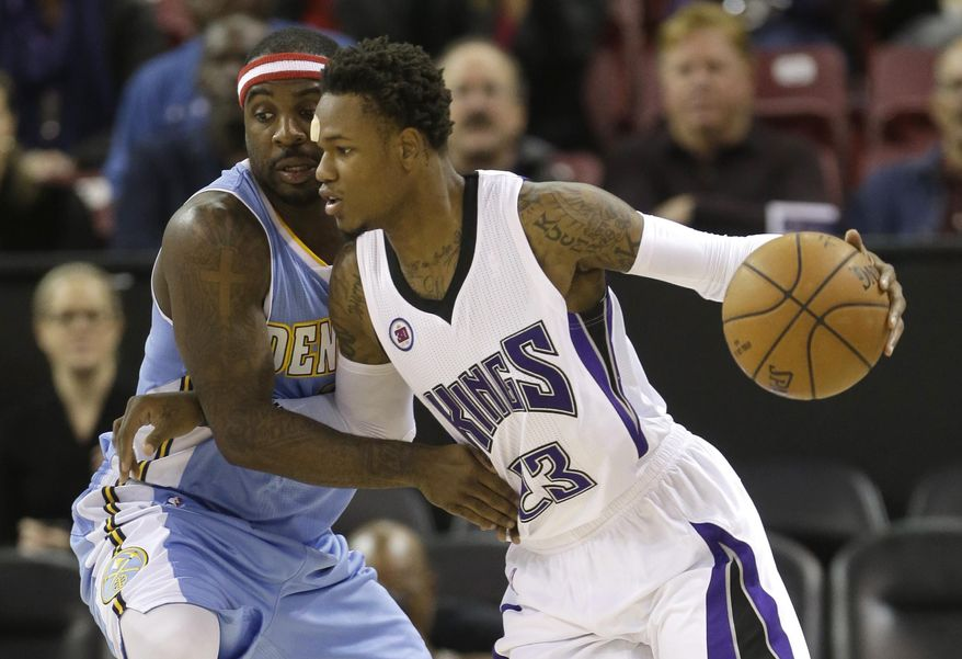 Denver Nuggets guard Ty Lawson, left, tries to stop the drive of Sacramento Kings guard Ben McLemore during the first half of an NBA basketball game in Sacramento, Calif., Wednesday, Nov. 5, 2014..(AP Photo/Rich Pedroncelli)