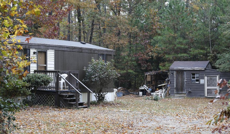 The home of Delvin Barnes sits unoccupied in Charles City, Va., Thursday, Nov. 6, 2014.  Police arrested Barnes, 37, on charges that he abducted and attempted to kill a 16-year-old Virginia girl. A GPS device installed on the car he was driving led police to capture him in a case involving an abduction in Philadelphia. (AP Photo/Steve Helber)