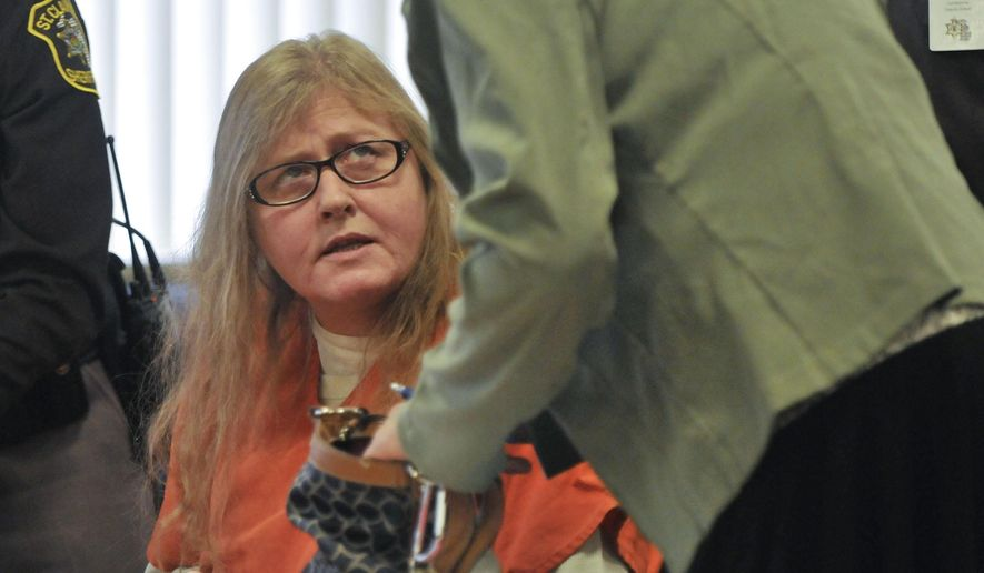 Judy Higley-Zuehlke speaks with her attorney Sharon Parrish after being sentenced, Thursday, Nov. 6, 2014 in Port Huron, Mich.  Judy Higley-Zuehlke who was convicted of killing her former boyfriend has been sentenced to 28 to 55 years in prison. (AP Photo/The Port Huron Times Herald, Mark R. Rummel)  NO SALES