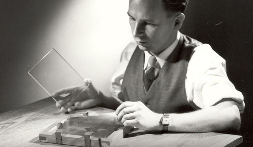 FILE- In this 1950 photo provided by Corning Inc., Dr. Don Stookey prepares to expose an image to ultraviolet light.  Stookey, who forever changed cooking with the invention of CorningWare, died Tuesday, Nov. 4, 2014, at an assisted living center in Rochester, New York. He was 99.(AP Photo/Corning, Inc.)