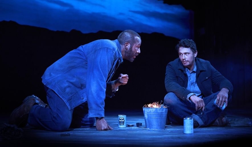 """This image released by Polk & Co. shows James Franco, right, and Chris O'Dowd in a scene from """"Of Mice and Men,"""" in New York.  A high-definition broadcast of Franco starring on Broadway this summer in John Steinbeck's """"Of Mice and Men"""" will compete with the movies """"Nightcrawler"""" and """"Gone Girl"""" at the box office, and it marks an important milestone. While a few Broadway shows have been broadcast, this is the first time the National Theatre Live series, the gold standard, has chosen a Broadway show to beam into over 900 venues across the U.S. and Canada.  (AP Photo/Polk & Co., Richard Phibbs)"""