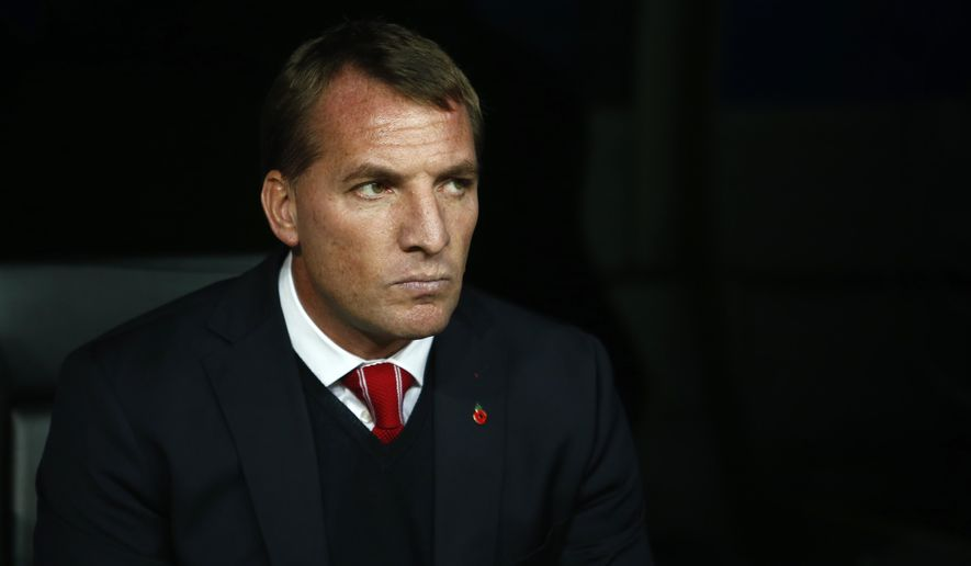 Liverpool's head coach Brendan Rodgers takes his seat before a Group B Champions League soccer match between Real Madrid and Liverpool at the Santiago Bernabeu stadium in Madrid, Spain, Tuesday Nov. 4, 2014. (AP Photo/Andres Kudacki)