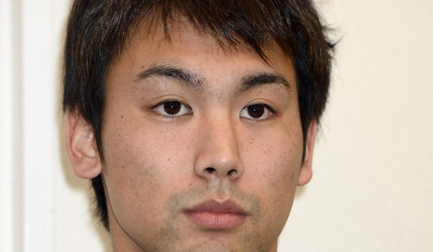 Japanese swimmer Naoya Tomita, who was suspended for stealing a camera at the Asian Games, attends a news conference in Nagaya, central Japan, Thursday, Nov. 6, 2014. Tomita has denied the allegations, claiming someone placed the camera in his gym bag. He initially admitted to stealing a camera left poolside by a South Korean reporter on Sept. 25 at the games in Incheon, South Korea. (AP Photo/Kyodo News)  JAPAN OUT, MANDATORY CREDIT