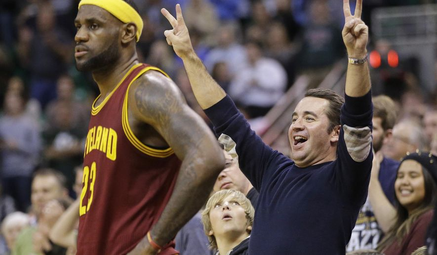 A Utah Jazz fan celebrates as Cleveland Cavaliers' LeBron James (23) waits during the second half of an NBA basketball game Wednesday, Nov. 5, 2014, in Salt Lake City. The Jazz won 102-100. (AP Photo/Rick Bowmer)