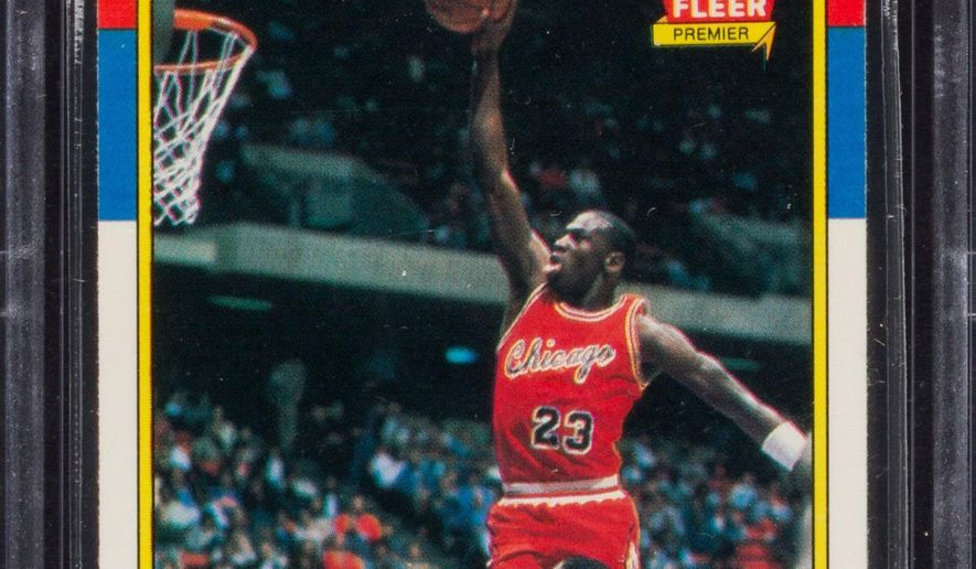 This image provided by Heritage Auctions in Dallas shows a 1986 Michael Jordan rookie trading card. Heritage Auctions expects the Fleer card top condition to garner more than $80,000 at auction.  It is expected to sell sometime after midnight Thursday, Nov. 6, 2014. (AP Photo/Heritage Auctions)