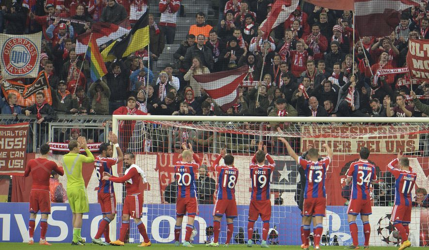 Munich teammates celebrate with supporters after winning the Champions League group E soccer match between Bayern Munich and Roma in Munich, Germany, on Wednesday, Nov. 05, 2014. Munich won by 2-0. (AP Photo/Kerstin Joensson)