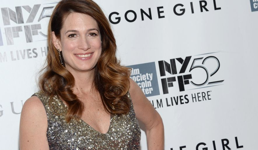 "FILE - In this Sept. 26, 2014 file photo, author Gillian Flynn arrives at 2014 NYFF - ""Gone Girl"" opening night world premiere in New York. Flynn, Philip Roth, and Don DeLillo are among 75 authors and artists contributing annotated editions of their work for a PEN American Center auction. PEN, the literary and human rights organization, announced Thursday, Nov. 6, 2014 that the ""First Edition/Second Thoughts"" auction will be held Dec. 2 at Christie's New York. (Photo by Evan Agostini/Invision/AP, File)"