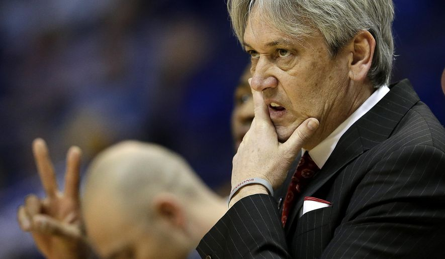 FILE - In this March 21, 2014, file photo, New Mexico coach Craig Neal watches during the first half of a second-round game against Stanford in the NCAA college basketball tournamentin St. Louis. Bereft of three of the top players to have donned a New Mexico uniform, second-year coach Craig Neal is trying to mold a winner from what is largely a collection of newcomers and seldom-used holdovers. (AP Photo/Charlie Riedel, File)