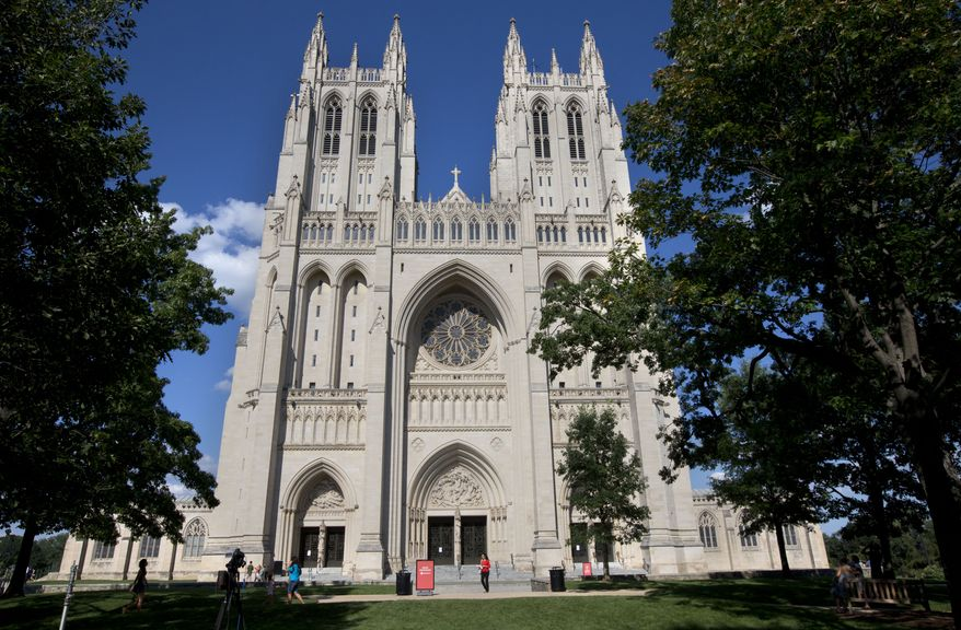 """At 7 p.m. on Friday, the Washington National Cathedral is hosting """"Letters from War: A Tribute to Veterans,"""" a tribute concert featuring the U.S. Marine Corps Orchestra and the Washington National Cathedral Choir. (Associated Press)"""