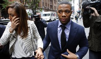 Ray Rice arrives with his wife Janay Palmer for an appeal hearing of his indefinite suspension from the NFL, Wednesday, Nov. 5, 2014, in New York. (AP Photo/Jason DeCrow)