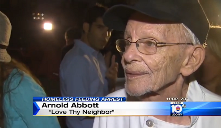 Arnold Abbott, head of the group Love Thy Neighbor, was back to handing out food to the needy Wednesday, undeterred by his arrest for feeding the homeless over the weekend. (Local 10 News)