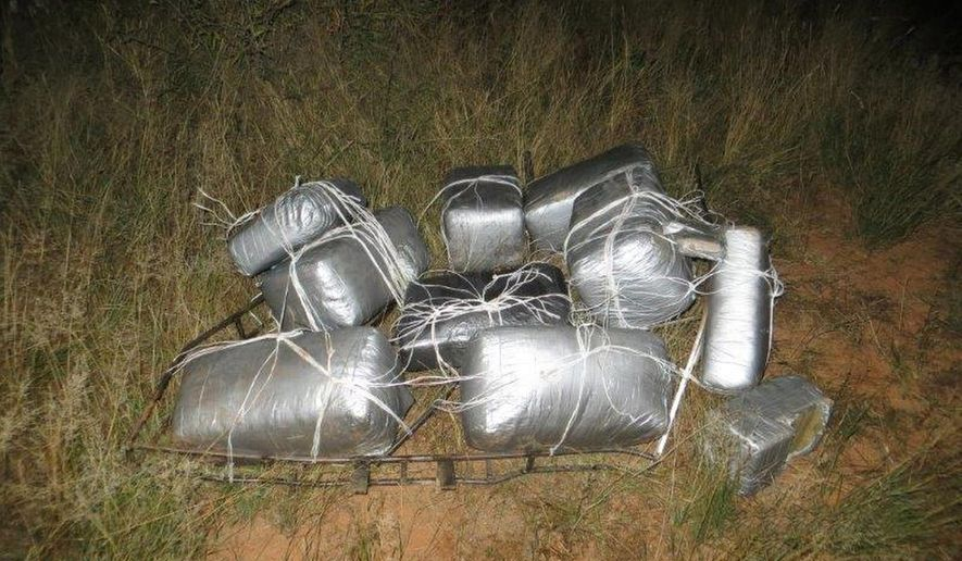 This undated photo provided by the U.S. Customs and Border Protection shows nearly 185 pounds of marijuana that was recovered after an ultralight aircraft was seen flying from Mexico into southeastern Arizona. Two people were arrested Wednesday, Nov. 5, 2014 near where the marijuana was found in the vicinity of Sunsites, a small community located about 40 miles north of the U.S.-Mexico border. According to the Border Patrol, camera operators from the agency's Douglas station observed the ultralight fly north over the border at approximately 3 a.m. It then was seen traveling south back into Mexico at approximately 4:45 a.m.  (AP Photo/U.S. Customs and Border Protection)