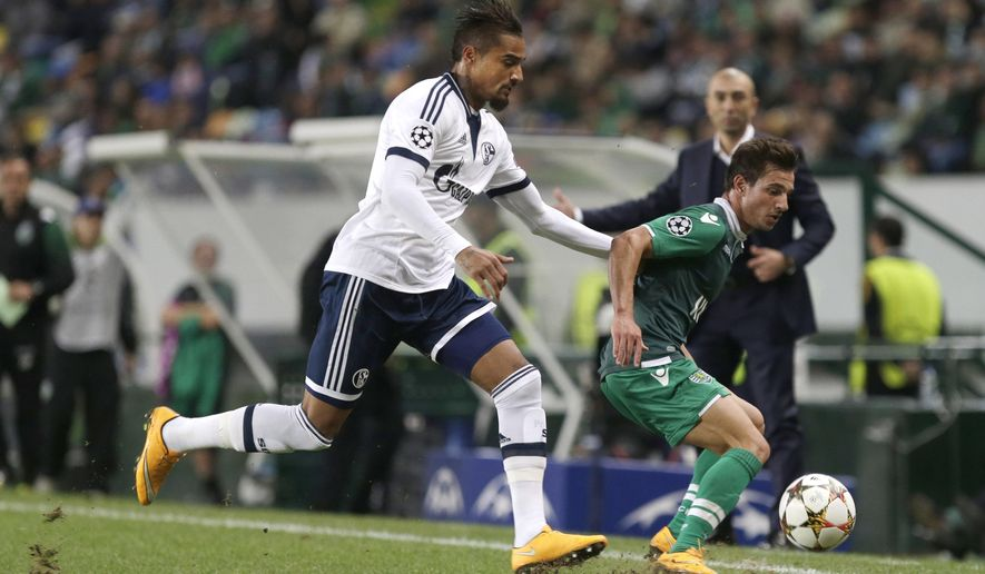 Schalke's Kevin-Prince Boateng, left, challenges for the ball with Sporting's Cedric Soares during a Champions League Group G soccer match between Sporting and Schalke 04 at Sporting's Alvalade stadium, in Lisbon, Wednesday, Nov. 5, 2014. (AP Photo/Francisco Seco)