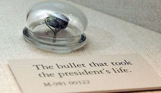 This undated image released by the National Museum of Health and Medicine shows the bullet that killed President Lincoln on April 15, 1865, on display at the National Museum of Health and Medicine in Silver Spring, Md. The bullet was removed at an autopsy in the White House by Army Medical Museum surgeons Lt. Col. Joseph Woodward and Major Edward Curtis. The display about Lincoln's death is one of a number of exhibits at the free museum, which is part of the Department of Defense. (AP Photo/National Museum of Health and Medicine)