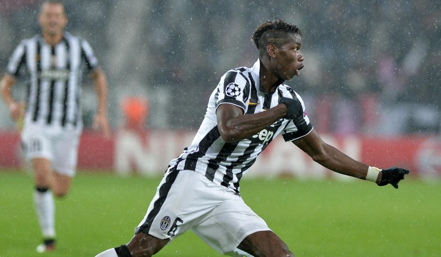 Juventus' Paul Pogba celebrates after scoring the third goal of his team during a Champions League, Group A soccer match between Juventus and Olympiakos, at the Juventus Stadium in Turin, Italy, Tuesday, Nov. 4, 2014. (AP Photo/Massimo Pinca)