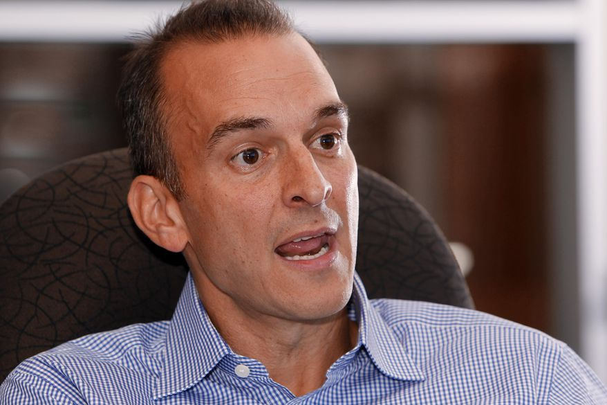 FILE - In this Oct. 16, 2012, file photo, Travis Tygart, the CEO of the U.S. Anti-Doping Agency, speaks during an interview at his office in Colorado Springs, Colo. An Associated Press analysis of the testing protocol, approved by the league and the NFL Players Association after more than three years of wrangling, found that only the most reckless or uninformed player would seem to have a chance of getting caught using HGH, which has become popular in a variety of sports for its supposed ability to enhance performance in various ways. Tygart and other leaders of the anti-doping movement agree that, while checking athletes for that specific performance-enhancer is better than not checking at all, testing alone merely skims the surface of what must be done to find cheaters _ especially given the limitations of a test that only is able to detect synthetic HGH in a person's system for 48 hours. (AP Photo/Ed Andrieski, File)