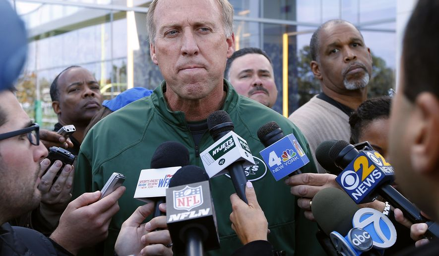 FILE - In this Monday, Oct. 20, 2014 file photo, New York Jets General Manager John Idzik talks about the trade for wide receiver Percy Harvin from Seattle during NFL football practice in Florham Park, N.J. Frustrated Jets fans have taken to the air to vent. Literally. A plane with a banner urging the team to fire John Idzik circled several times above the practice field for about 20 minutes Wednesday, Nov. 5, 2014 as the players went through drills while New York's embattled general manager watched. (AP Photo/Rich Schultz, File)