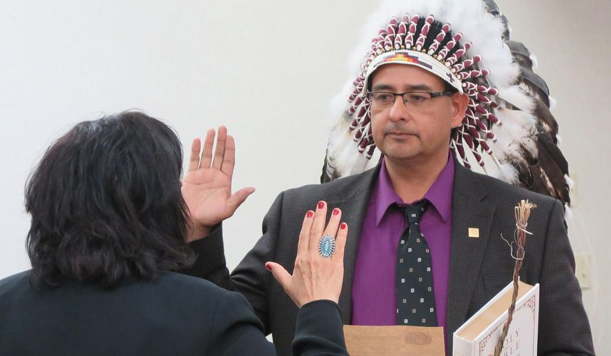 Mark Fox is sworn in as chairman of the Mandan, Hidatsa and Arikara Nation on Wednesday, Nov. 5, 2014 in New Town, N.D. Fox defeated tribal attorney Damon Williams by fewer than 150 votes in the Nov. 4 election. Fox says he hopes to restore transparency to tribal government on the oil rich Fort Berthold Indian Reservation. (AP Photo/Josh Wood)