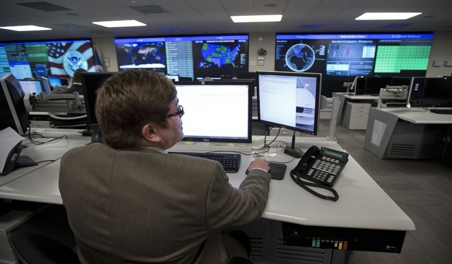 In this Tuesday, Sept. 9, 2014, file photo photo, specialists work at the National Cybersecurity and Communications Integration Center (NCCIC) in Arlington, Va. (AP Photo/Manuel Balce Ceneta) ** FILE **