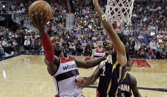 Washington Wizards guard John Wall (2) shoots as Indiana Pacers forward Chris Copeland (22) defends during the first half of an NBA basketball game, Wednesday, Nov. 5, 2014, in Washington. Wall had 31 points as the Wizards won 96-94 in overtime. (AP Photo/Alex Brandon)