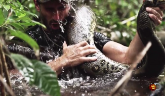 "Wildlife filmmaker Paul Rosolie plans to be consumed by ""the largest species of snake on earth"" while in a custom-built snake-proof suit on Discovery's new ""Eaten Alive"" special. (Discovery via YouTube)"