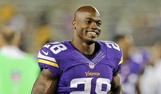 FILE - In this Aug. 8, 2014, file photo, Minnesota Vikings running back Adrian Peterson leaves the field after an NFL preseason football game against the Oakland Raiders in Minneapolis. Adrian Peterson avoided jail time on Tuesday, Nov. 4, 2014,  in a plea agreement reached with prosecutors to resolve his child abuse case. (AP Photo/Jim Mone, File)