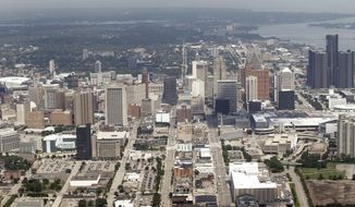 FILE - This July 17, 2013 aerial photo shows the city of Detroit. On Friday, Nov. 7, 2014, federal bankruptcy judge Steven Rhodes is expected to decide whether Detroit's plan to exit bankruptcy is fair and feasible. (AP Photo/Paul Sancya, File)