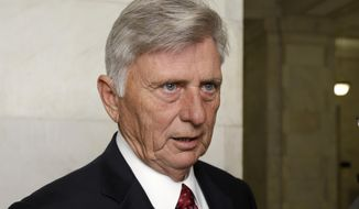 Arkansas Gov. Mike Beebe speaks to reporters at the Arkansas state Capitol in Little Rock, Ark., in this Nov. 5, 2014, file photo. Beebe announced on Wednesday his intent to grant 25 pardons. (AP Photo/Danny Johnston, File)
