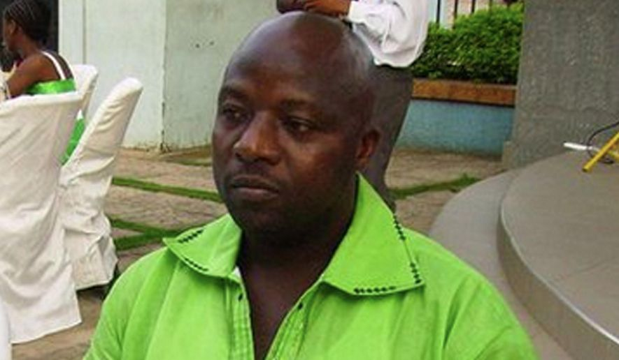This 2011 file photo provided by Wilmot Chayee shows Thomas Eric Duncan at a wedding in Ghana. Thirty-eight days after Duncan was diagnosed with Ebola in a local hospital where he died Oct. 8, Dallas calmly marked the end of its Ebola crisis on Friday, Nov. 7, 2014, when the last of the 177 people who were being monitored for symptoms of the deadly virus were to be cleared at midnight. (AP Photo/Wilmot Chayee, File)