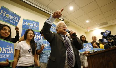 Rep. Mike Honda talks to supporters at his election night party at Zahir's Bistro in Milpitas, Calif.,on Tuesday, Nov. 4, 2014. (AP Photo/San Jose Mercury News, Josie Lepe)