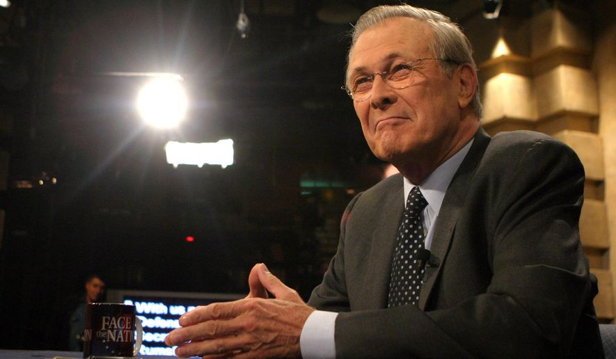 """FILE - In this Nov. 20, 2005 file photo provided by CBS, Defense Secretary Donald Rumsfeld appears on CBS's """"Face the Nation"""" in Washington. The Sunday morning public affairs show """"Face the Nation"""" celebrates 60 years of broadcasts this week, making it the second longest-running television program on the air. (AP Photo/CBS Face the Nation, Karin Cooper, File) MANDATORY CREDIT: FACE THE NATION/KARIN COOPER,  NO SALES, ARCHIVE OUT, NORTH AMERICA ONLY."""