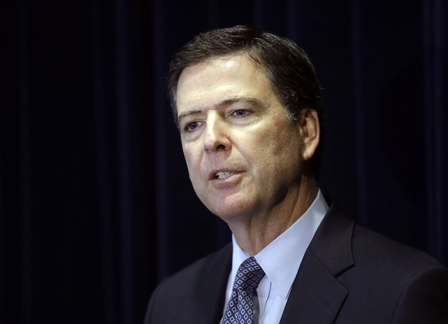 FBI Director James B. Comey speaks during a news conference in Portland, Ore., in this Oct. 1, 2014 file photo. (AP Photo/Don Ryan, File)