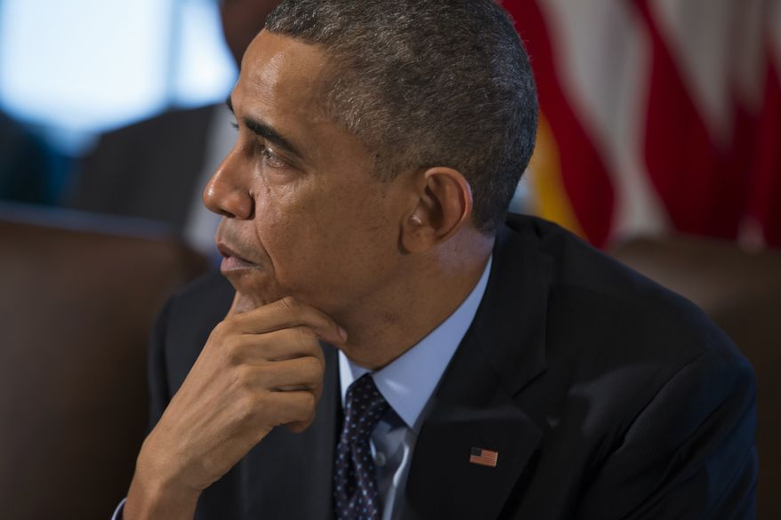 President Barack Obama pauses as he speaks to the media before a meeting with his cabinet members in the White House Cabinet Room in Washington, Friday, Nov. 7, 2014.  (AP Photo/Evan Vucci)