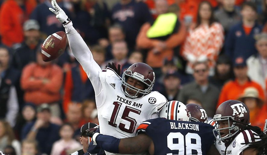 Texas A&M defensive lineman Myles Garrett (15) blocks a field goal attempt by Auburn at the end of the first half of an NCAA college football game on Saturday, Nov. 8, 2014, in Auburn, Ala. The Aggies' Deshazor Everett returned the kick 65-yards for a touchdown. (AP Photo/Butch Dill)