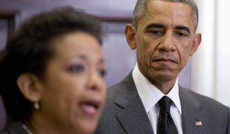President Barack Obama listens as U.S. Attorney Loretta Lynch speaks, in the Roosevelt Room of the White House in Washington, Saturday, Nov. 8, 2014, where the president announced that he will nominate Lynch to replace Attorney General Eric Holder. (AP Photo/Carolyn Kaster)