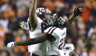 Texas A&M's Alonzo Williams (83) celebrates with teammates after recovering a fumble to secure a 41-38 win over Auburn  late in the second half of an NCAA college football game on Saturday, Nov. 8, 2014, in Auburn, Ala. (AP Photo/Butch Dill)