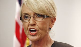 Arizona Republican Gov. Jan Brewer speaks at a news conference in Phoenix on Feb. 26, 2014. (Associated Press) **FILE**