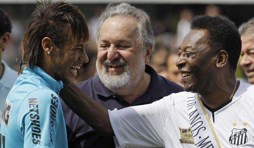 FILE - In this April 14, 2012 file photo, soccer player Neymar, left, and former soccer player Pele, right,  shares a laugh during the centennial anniversary celebration of the team in Santos, Brazil. Brazil's most promising player in decades is living up to expectations, enchanting with his skills and putting up numbers that set him on a path to greatness. He is already Brazil's fifth-greatest goal scorer, and is well on pace to surpass Pele's record as the nation's most prolific scorer. If Neymar keeps scoring like this, he may break Pele's record before he turns 28 in 2020. Pele was only two months older than Neymar when he netted his 40th goal. Only Pele and Romario have a better goal average than Neymar with the national team. (AP Photo/Nelson Antoine, File)