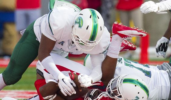 Tulane linebacker Nico Marley, left, and Edward Williams, right, sack Houston quarterback Greg Ward, during the first half of an NCAA football game at TDECU Stadium, Saturday, Nov. 8, 2014, in Houston. (AP Photo/Houston Chronicle, Cody Duty)