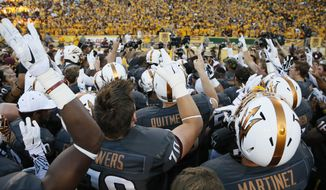 Arizona State players salute their fans after their 55-31 win over Notre Dame in an NCAA college football game against Notre Dame, Saturday, Nov. 8, 2014, in Tempe, Ariz.  (AP Photo/Matt York)