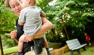 Most Americans - 52 percent - are comfortable seeing someone carry a handgun, in a holster in public. (Andrew Harnik/The Washington Times)