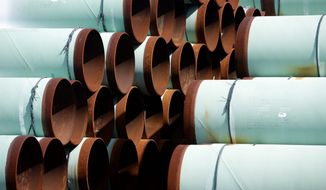 Some of more than 350 miles of pipe awaiting shipment for the Keystone XL oil pipeline is stored at Welspun Tubular, in Little Rock, Ark., Wednesday, Aug. 20, 2014. (AP Photo/Danny Johnston) ** FILE **