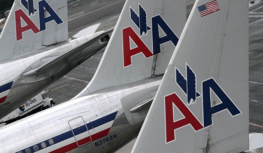 In this Wednesday, Aug. 1 2012, file photo, American Airlines airplanes are parked at their gates at JFK International airport in New York. (AP Photo/Mary Altaffer, File)