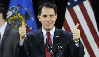 In a Tuesday, Nov. 4, 2014, file photo, Wisconsin Republican Gov. Scott Walker gives a thumbs up as he speaks at his campaign party, in West Allis, Wis. (AP Photo/Morry Gash, File)