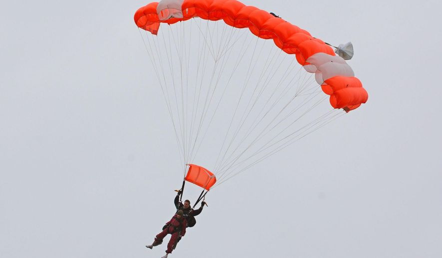Eleanor Cunningham skydives with Saratoga Skydiving Adventures, Saturday, Nov. 8, 2014, in Gansevoort, N.Y., a day after her 100th birthday. It was Cunningham's third jump, after taking up the sport at age 90. (AP Photo/The Daily Gazette, Patrick Dodson)  TROY, SCHENECTADY; SARATOGA SPRINGS; ALBANY AND AMSTERDAM OUT