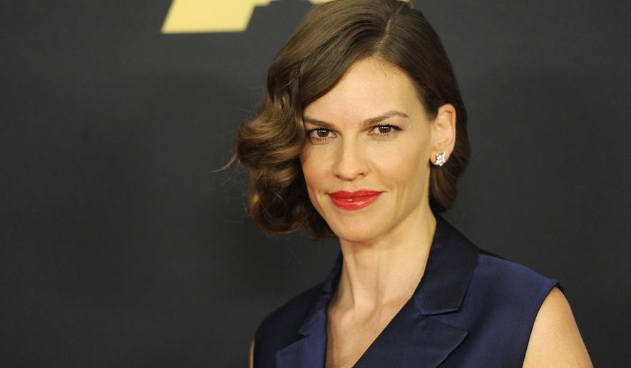 """Hilary Swank arrive at the 6th annual Governors Awards at the Hollywood and Highland Center on Saturday, Nov. 8, 2014 in Los Angeles. Swank is starring in the upcoming Blumhouse thriller """"The Hunt,"""" due to release Sept. 27, 2019. (Photo by Chris Pizzello/Invision/AP)"""