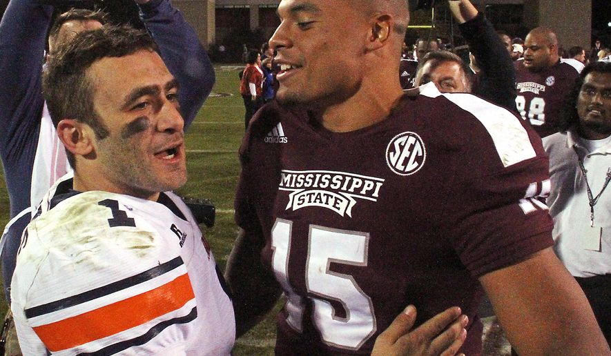 Tennessee-Martin quarterback Dylan Favre (1) congratulates Mississippi State quarterback Dak Prescott (15) after Mississippi State's 45-16 win in an NCAA college football game in Starkville, Miss., Saturday, Nov. 8, 2014. (AP Photo/Jim Lytle)