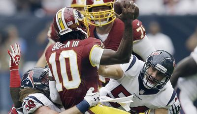 Washington Redskins' Robert Griffin III (10) is sacked by Houston Texans' Brooks Reed (58) during the first quarter of an NFL football game Sunday, Sept. 7, 2014, in Houston. (AP Photo/David J. Phillip)
