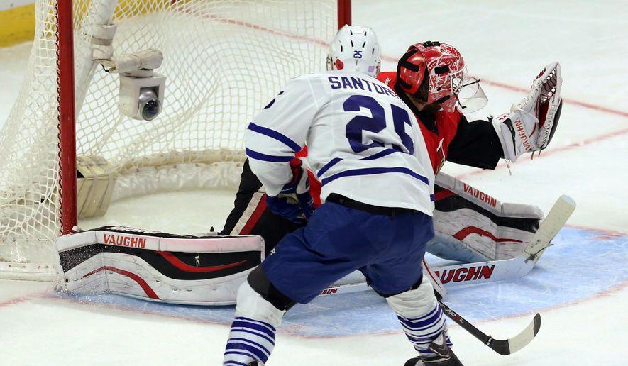 Toronto Maple Leafs' Mike Santorelli (25) scores on Ottawa Senators goaltender Robin Lehner (40) during the second period of an NHL hockey game in Ottawa, Ontario, Sunday, Nov. 9, 2014. (AP Photo/The Canadian Press, Fred Chartrand)